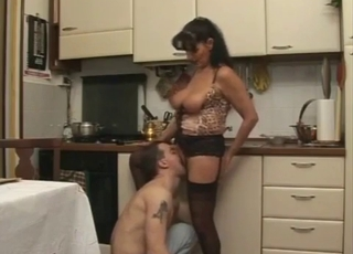 Busty stepmom sucks her son with passion