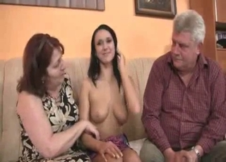 Mom licks her daughter's cunt on the sofa